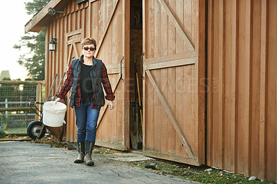 Buy stock photo Shot of a confident mature woman working on a farm