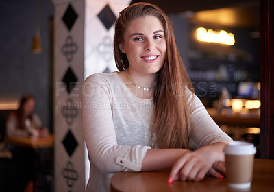 Buy stock photo Cropped portrait of an attractive young woman sitting in a coffee shop