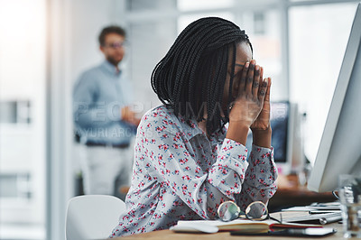Buy stock photo Shot of a young woman suffering from stress while using a computer at her work desk