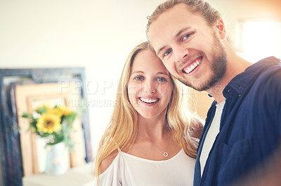 Buy stock photo Portrait of a young couple moving in to their new home