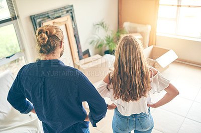 Buy stock photo Rearview shot of a young couple moving in to their new home