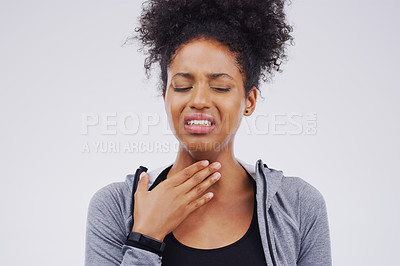 Buy stock photo Studio shot of a young woman suffering with a sore throat against a grey background