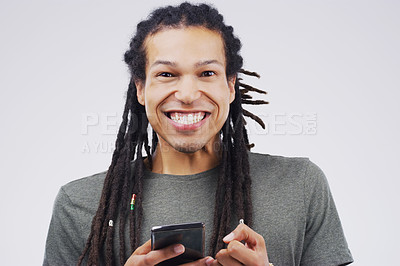 Buy stock photo Studio shot of a happy young man using his cellphone