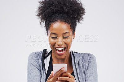 Buy stock photo Shot of a young woman reading something on her cellphone