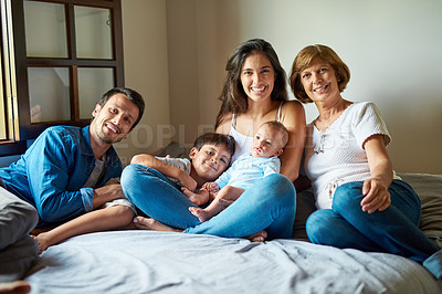 Buy stock photo Portrait of a beautiful family posing together at home
