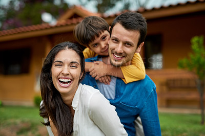 Buy stock photo Portrait of a beautiful young family spending some time together outdoors
