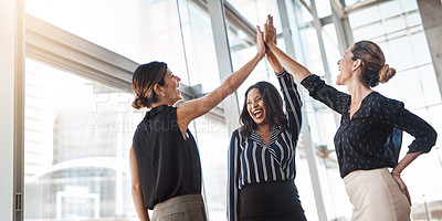Buy stock photo Shot of two well-dressed businesspeople high fiving in the office
