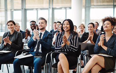 Buy stock photo Shot of a group of businesspeople clapping during a conference