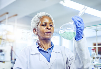 Buy stock photo Shot of a mature scientist working in a lab