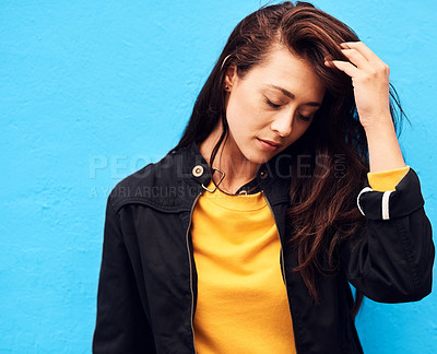 Buy stock photo Shot of a attractive young woman  posing against a blue background