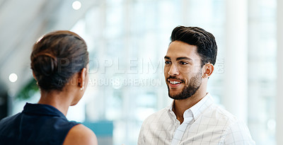 Buy stock photo Shot of two young businesspeople having a discussion together inside of the office at work