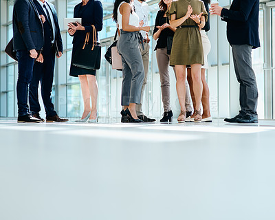 Buy stock photo low angle shot of a group of businesspeople greeting each other inside of a office at work