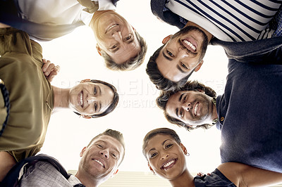Buy stock photo Portrait of a group of businesspeople joining their heads together in a huddle