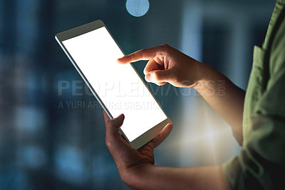 Buy stock photo Cropped shot of an unrecognizable businessman working late at night on his tablet in the office
