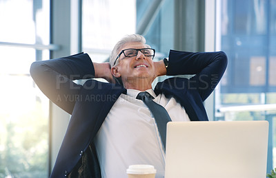 Buy stock photo Shot of a mature businessman taking a break while working in an office