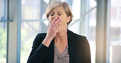 Buy stock photo Shot of a mature businesswoman yawning in an office
