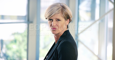 Buy stock photo Portrait of a mature businesswoman pouting in an office