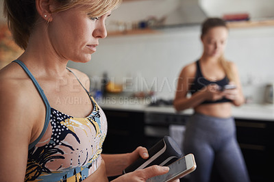 Buy stock photo Shot of a cheerful young woman using her cellphone well waiting for a yoga session
