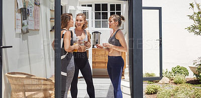Buy stock photo Shot of a group of cheerful young people having a discussion outside of a yoga studio after a session workout