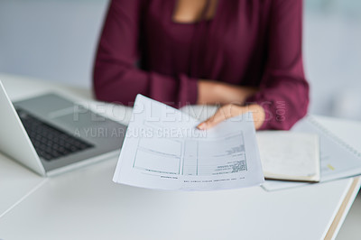 Buy stock photo Cropped shot of a businesswoman handing over a document at her desk
