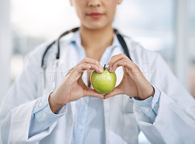 Buy stock photo Closeup shot of an unidentifiable doctor holding an apple