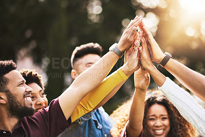 Buy stock photo Cropped shot of a group of friends high fiving