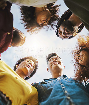 Buy stock photo Low angle shot of a group of friends standing together