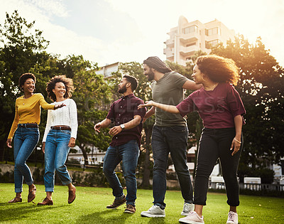 Buy stock photo Shot of a group of friends spending the day outdoors