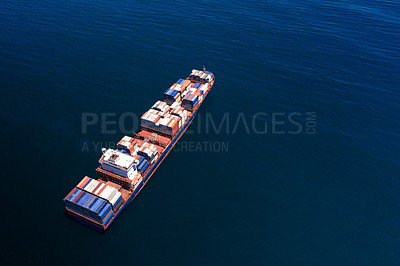 Buy stock photo Shot of a cargo ship at sea