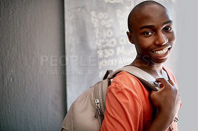 Buy stock photo Portrait of a cheerful young student on his way to class while carrying his bag during the day