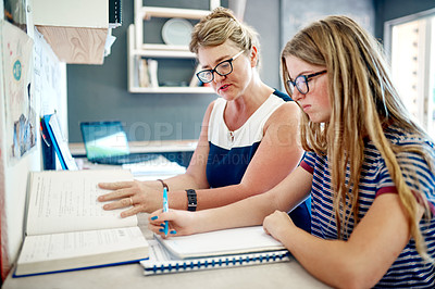 Buy stock photo Cropped shot of a confident middle aged teacher helping her students in class during the day