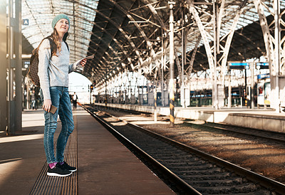 Buy stock photo Full length shot of an attractive young woman waiting for a train at the station