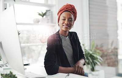 Buy stock photo Cropped portrait of an attractive young businesswoman working at her desk in the office