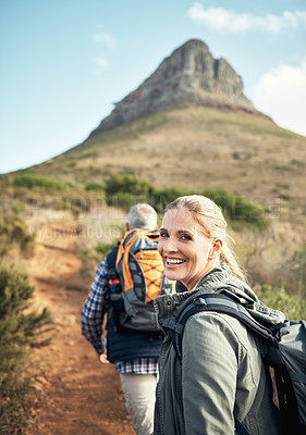 Buy stock photo Portrait of a mature woman hiking with her husband through the mountains