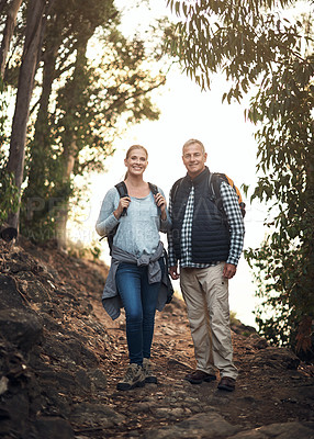 Buy stock photo Portrait of a mature couple hiking through the mountains