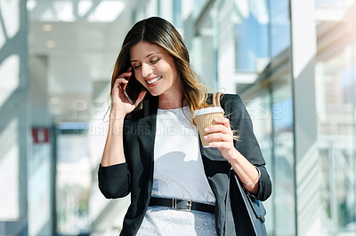 Buy stock photo Cropped shot of an attractive young businesswoman taking a phone call in her workplace