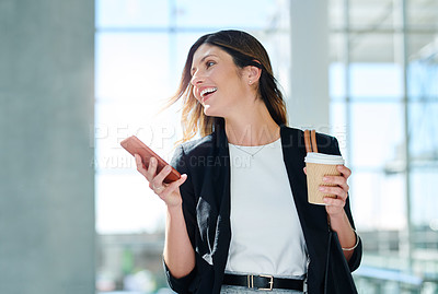 Buy stock photo Cropped shot of an attractive young businesswoman using her smartphone in her workplace