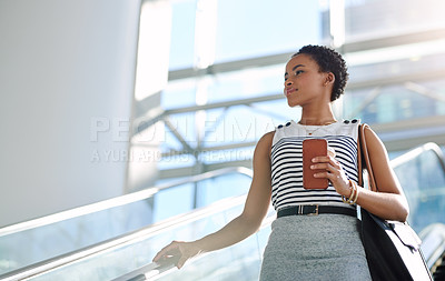 Buy stock photo Cropped shot of an attractive young woman on an escalator in her workplace