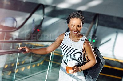 Buy stock photo Cropped portrait of an attractive young woman on an escalator in her workplace