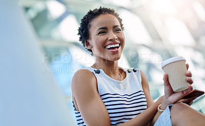 Buy stock photo Cropped shot of an attractive young businesswoman laughing in her workplace