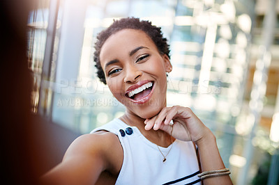 Buy stock photo Cropped portrait of an attractive young businesswoman taking a selfie in the workplace