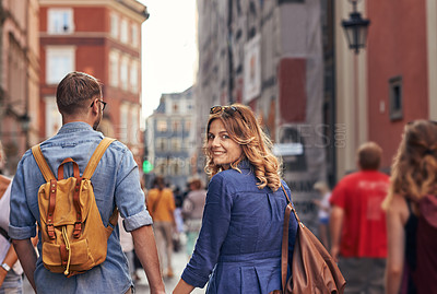 Buy stock photo Cropped shot of a happy young couple walking through a foreign city