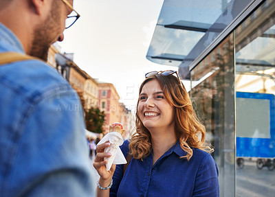 Buy stock photo Shot of a young woman having ice cream while talking to someone