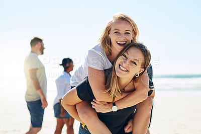 Buy stock photo Portrait shot of two young women at the beach with their friends