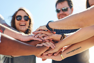 Buy stock photo Cropped shot of a group of people joining hands in solidarity