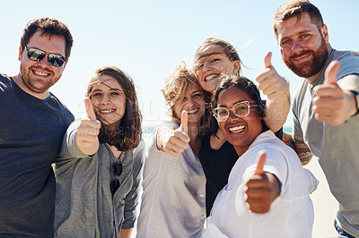 Buy stock photo Shot of a group of friends showing thumbs up