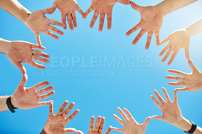 Buy stock photo Cropped shot of a group of unrecognizable people forming a circle with their hands