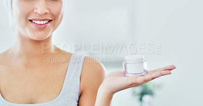 Buy stock photo Cropped shot of an unrecognizable woman holding a skincare product