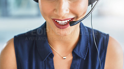 Buy stock photo Cropped shot of a cheerful young unrecognizable businesswoman talking on a headset to clients while working inside of the office
