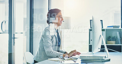 Buy stock photo Cropped shot of a focused young businesswoman talking on a headset to clients while working inside of the office